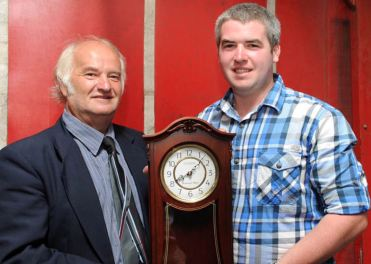 Terry Adams, Courtmacsherry Hotel, pictured left, presents the Courtmacsherry Harbour Festival Recognition Award to Stephen Finn. The award was made posthumously in honour of Jerry Finn, who passed away earlier this year. Photo: Martin Walsh.