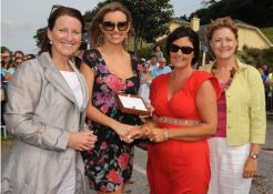 "LADY IN RED: Angela O'Donovan, Timoleague (second from left) winner of the ""Best Dresed Ladt Competition"" at the Courtmacsherry Strand Races receives her prize from former Miss World, Rosanna Davidson. Also included are judges, Colette Flynn (left) and Mary Madden. Photo: Martin Walsh."
