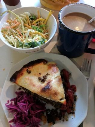 Yummy tortierre with salad and sauerkraut.