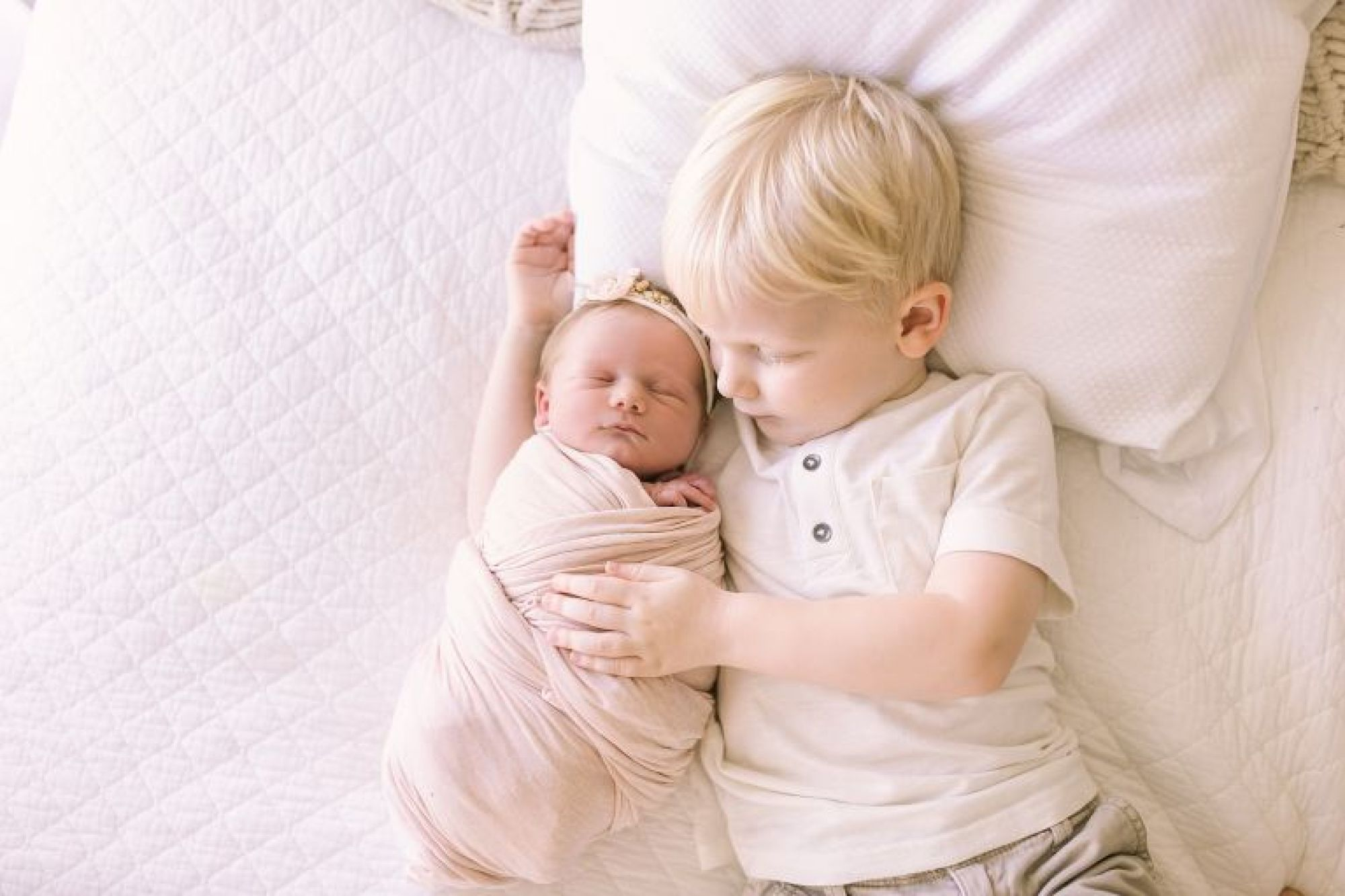 Big brother and baby sister during newborn photoshoot with Courtney Griffin Photography.