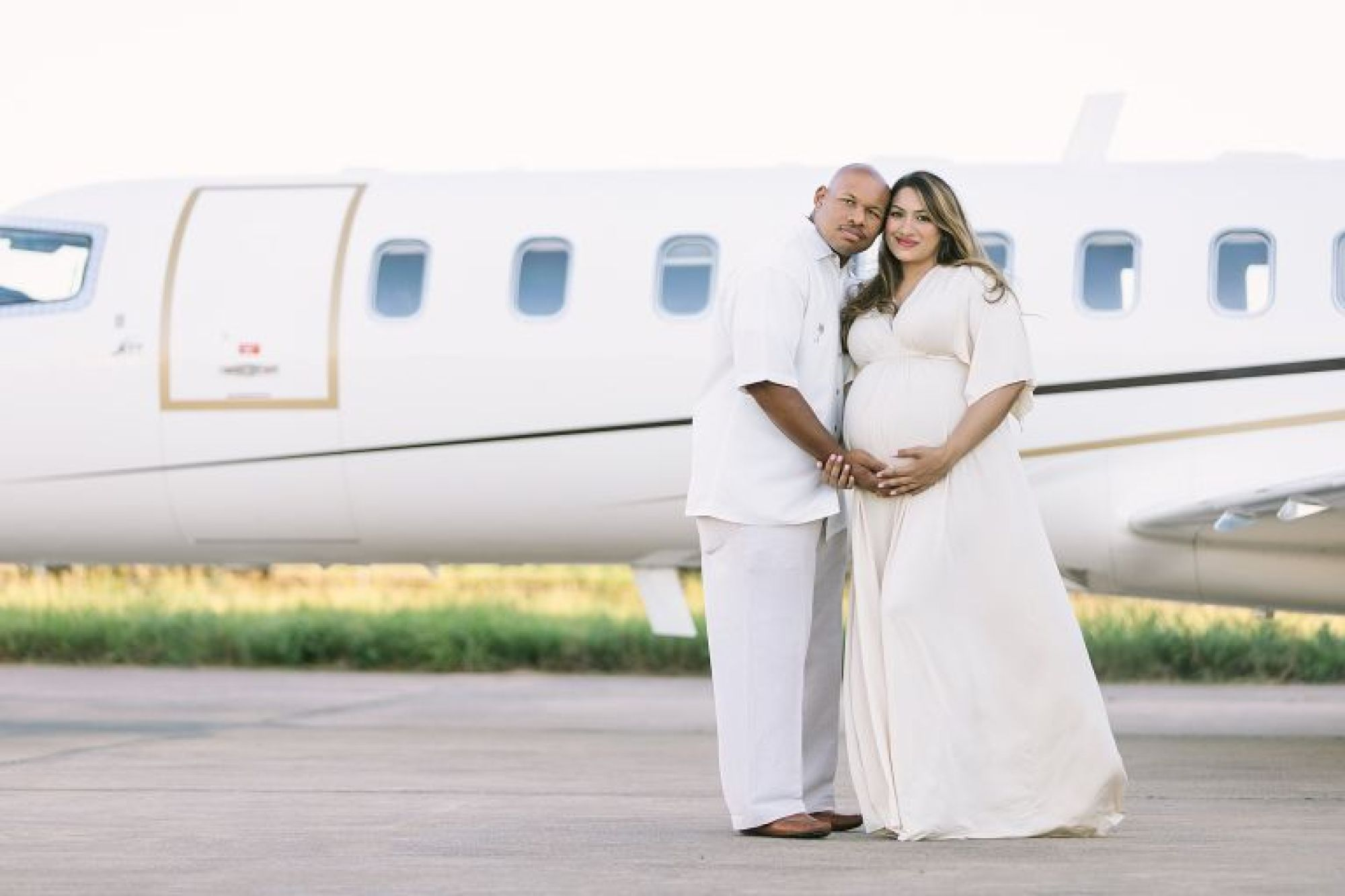 Maternity photoshoot at airport in Memorial City, TX. Photos by Courtney Griffin Photography.