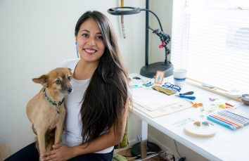headshot of Lys with her dog in her studio