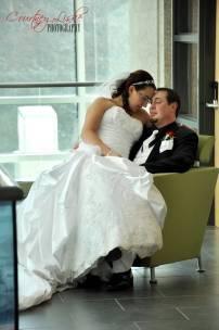 Ashlee & Matt - Cuddling in a chair - Regina Wedding Photography