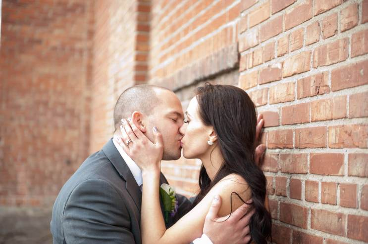 Regina Wedding Photographer - Andrew & Alicia - Brick Wall Kiss