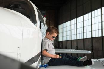 Ty on plane with aviators at the Regina Flying Club - Favel Family 2015