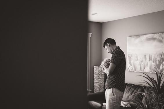 The love of a father in-home newborn photography session