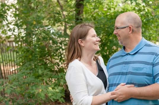 Couple cuddling in the garden near Regina