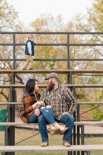 Husband and wife sitting in the bleachers