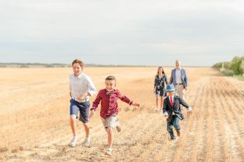 Regina Family Photographer - Running through wheat fields
