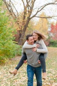 Couple laughs together as they walk through Wascana Park