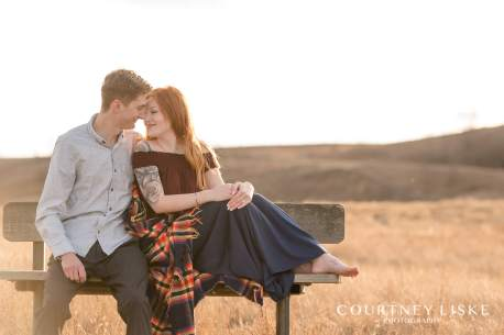 Couple sitting on a bench at Wascana Trails near Regina Saskatchewan