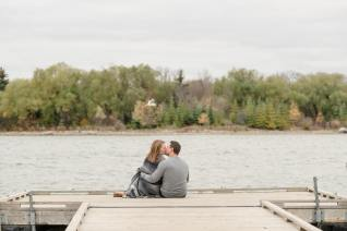 Couple sitting on a dock overlooking Wascana Lake