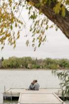 Looking out over the water on a dock in Wascana Lake