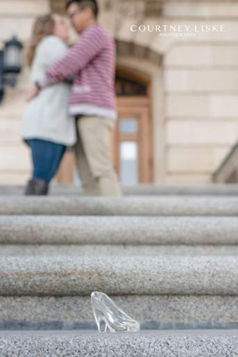 Cinderella slipper left on the stair with couple in the background