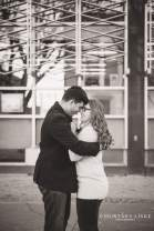Couple stands in embrace outside the Regina Public Library