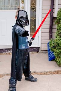 Boy dressed as Darth Vader for Halloween