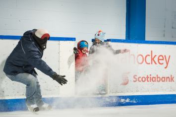 Kids getting sprayed with ice shavings at Mahon arena