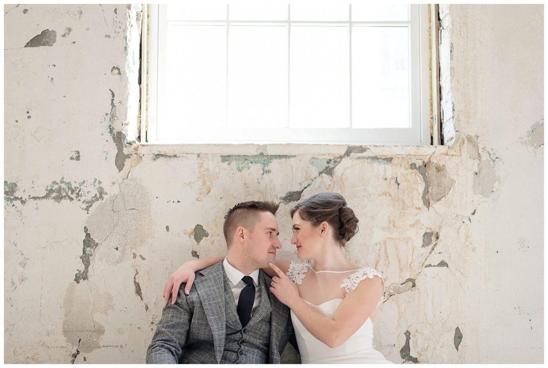 Mark & Kyra - Wedding - 01 - Weston Bakery - Sitting against wall