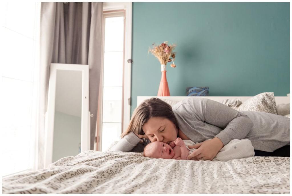 Regina Family Photographer - Jensen Newborn - Keltie-Jensen - In home Family Session - Teal Bedroom Wall - Kisses for baby