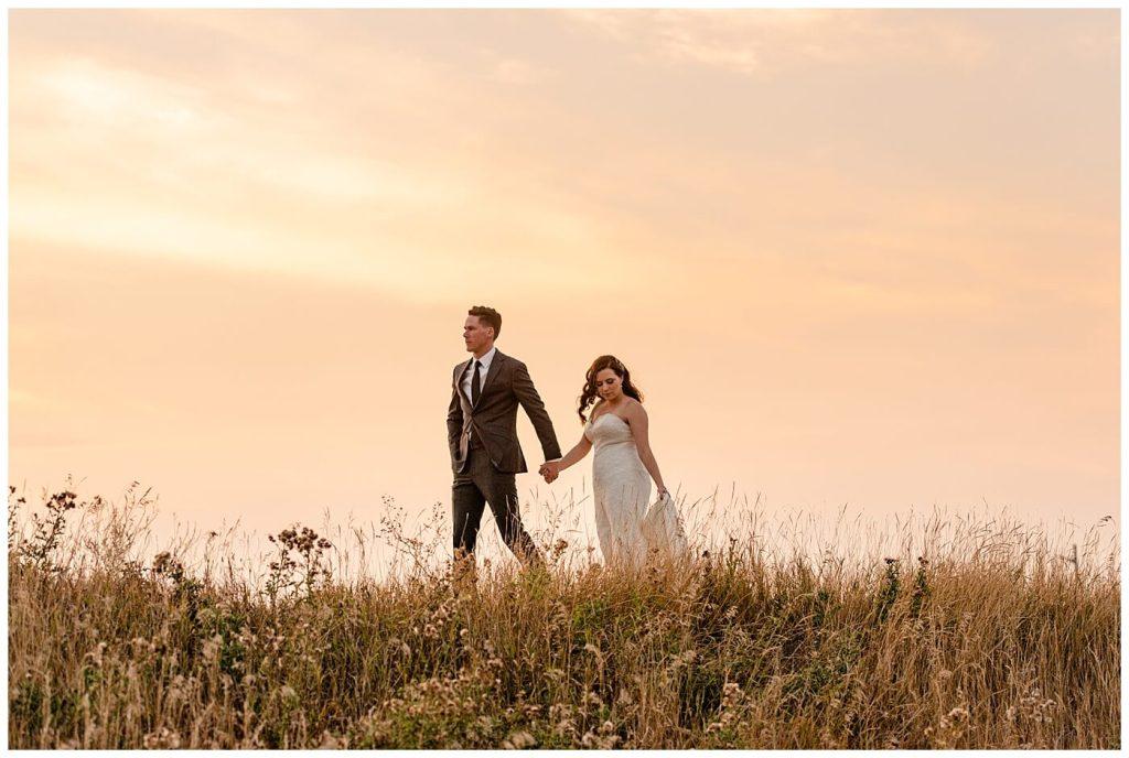 Regina Wedding Photographer - Tim & Jennelle At Home Wedding - Sunset Photo of bride and groom walking