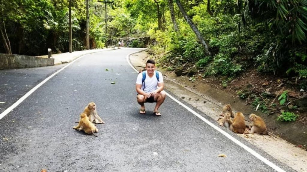 Teaching in Cambodia - Alfredo stopped to take a photo with monkeys