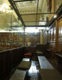 Glass dock in courtroom