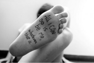the bottom of a foot with a message of hope written on it with a marker