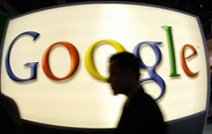 Google logo with silhouette of man's head in front of it