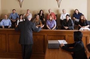 attorney addressing jurors in a jury box