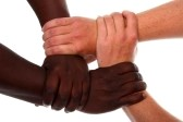 black and white hands clasped in a gesture of teamwork