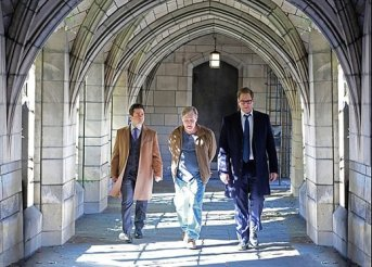 "Characters from television's ""Bull"" walking through a church corridor"