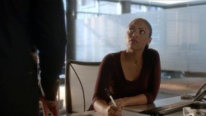 Woman sitting at desk from Bull TV show