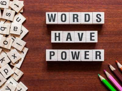 Words Have Power spelled out with Scrabble tiles