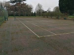 A tennis court in Sissinghurst before cleaning and restoration