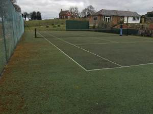 A tennis court in Wadhurst before restoration