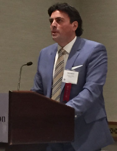 Richard A. Klass in blue suit with colorful tie at the annual meeting of the New York State Bar Association's General Practice Section, February 23, 2015