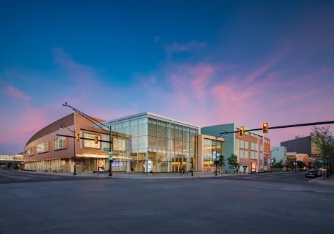 Columbus Ohio convention center exterior against a nighttime skyline