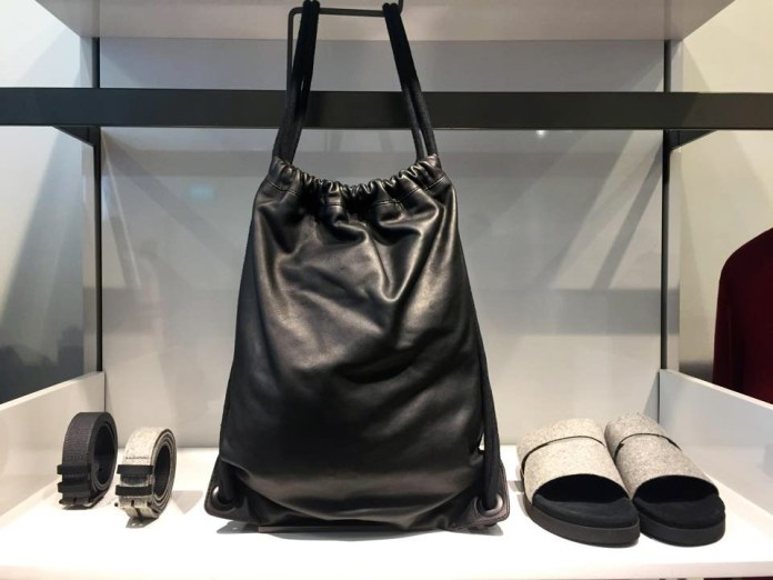 leather and wool sportsbag, sandals and felted belt