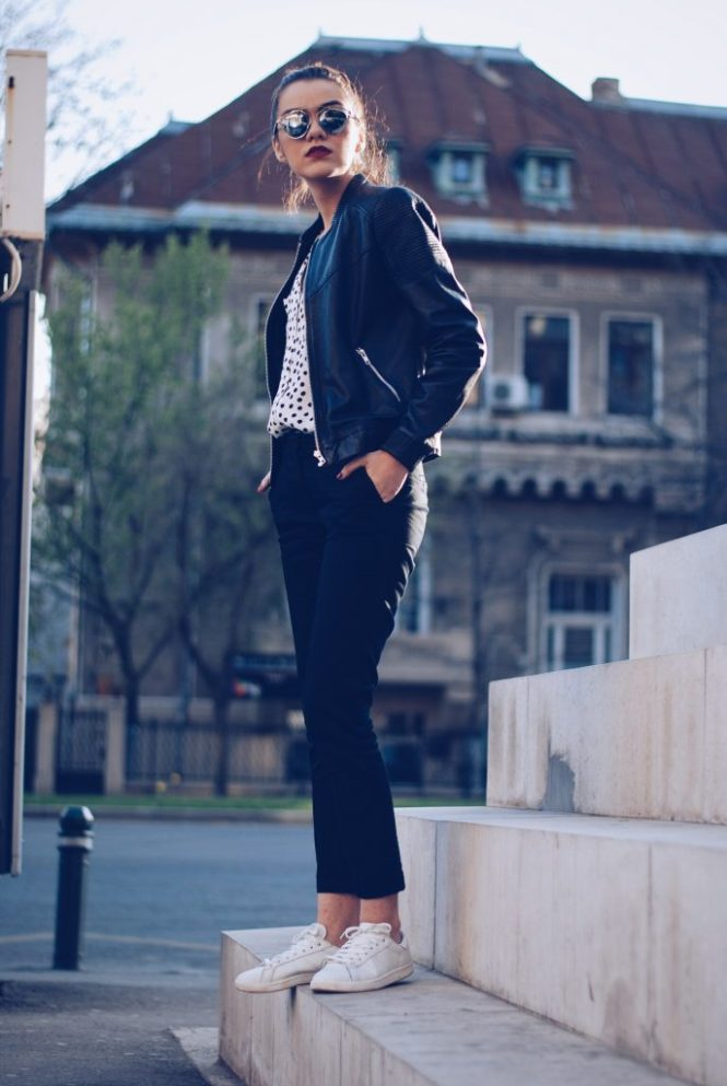 Leather jacket, polka dot shirt, black trousers, white sneakers, so real sunglasses by Andreea Birsan
