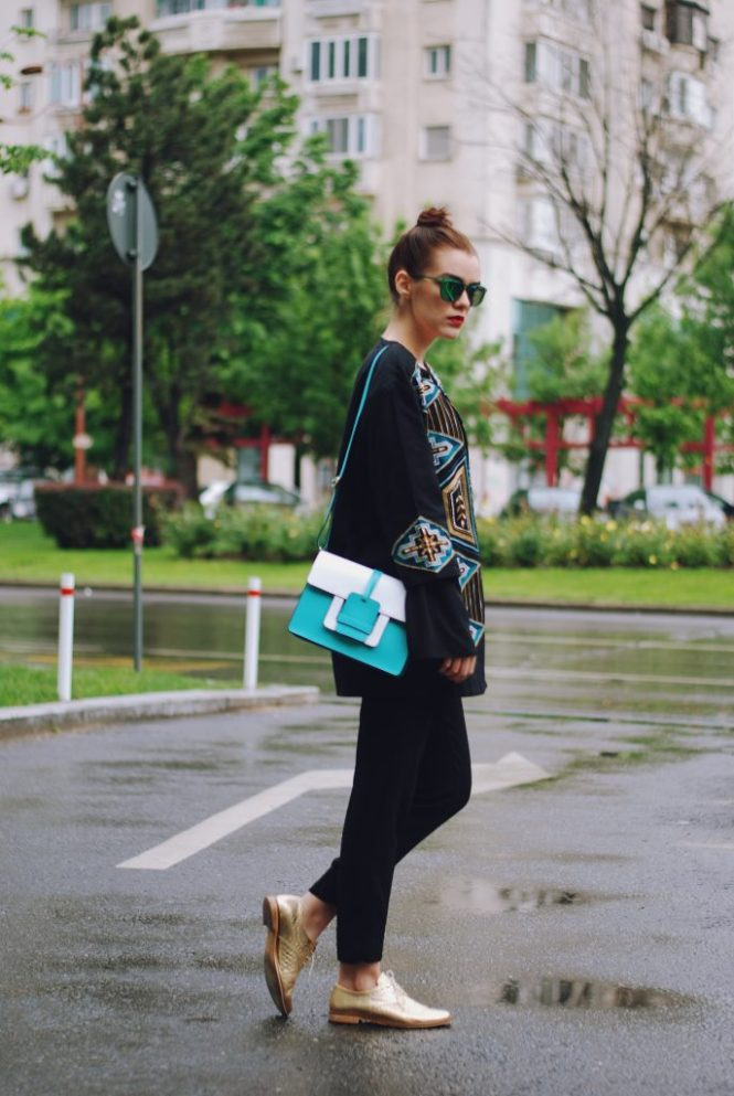 Embellished jacket, black bell sleeve blouse, black trousers, golden metallic shoes, green sunglasses, leather bag, spring outfit by Andreea Birsan