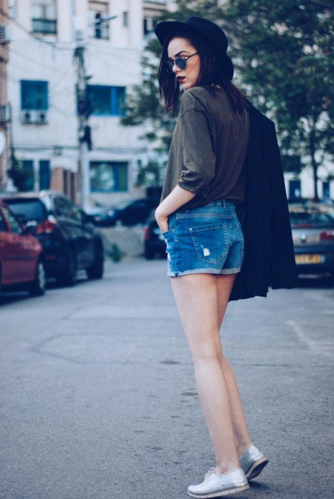 Black hat, khaki shirt, pinstripe blazer, so real sunglasses, denim shorts, silver metallic shoes, black leather bag, spring outfit by Andreea Birsan
