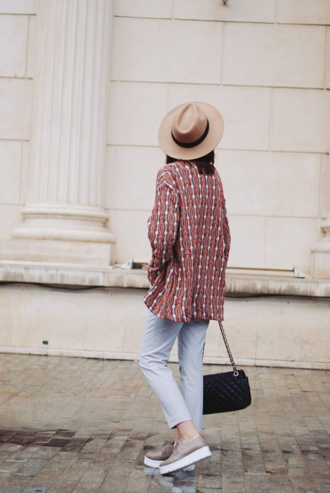 Patterned jacket, camel hat, so real sunglasses, grey trousers, graphic tshirt, nude shoes, black bag, spring outfit by Andreea Birsan