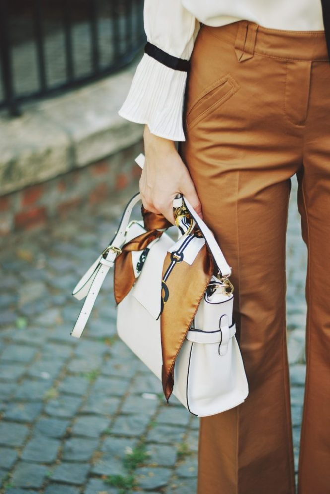 Camel fedora hat, camel flared pants trousers, ruffle top, scarf, white crossbody bag, beige pumps, dior sunglasses, cute autumn outfit idea, Andreea Birsan