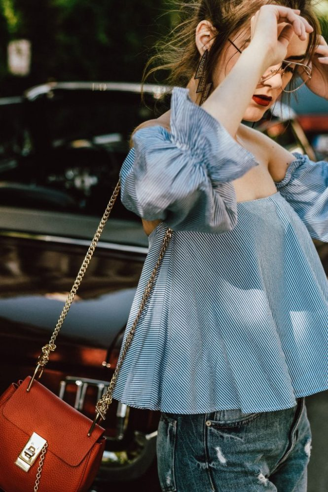 Zara srtiped off shoulder top, girly blouse, ots top, off the shoulder top, blue, baby blue, levi's jeans, mom jeans, boyfriend jeans, summer blouse, how to wear an off shoulder top, topshop pearled mom jeans, zara pearl jeans, the most seen jeans on instagram, the popular clear lens glasses from instagram, asos suede red pumps, real leather, river island slingback shoes, red chloe drew crossbody bag, ray ban aviator clear lens glasses, andreea birsan, couturezilla, cute summer outfit 2017, boohoo, mango outfit, how to wear mom jeans like a pro, fashionista, european fashion blogger, european fashion blog, summer in europe, how to dress for summer, how to look parisian chic, dark red ford mustang, vintage car, sports car, burgundy, statement earrings, jewelry, how to look cute in jeans and a top, chic summer outfit for women, cool kids, casual pinterest summer outfit for women, woman, photos, tumblr girls pictures, summer trends 2017, how to wear jeans in summer, dress for the warm weather, bamboo, bucharest streets, explore, ootd, outfit of the day, classy with a twist, how to wear kitten heels, moden minimalism, stripe off shoulder top