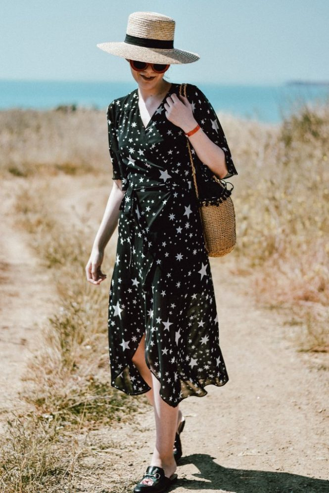 Zara star printed midi wrap dress, mango star print dress, beach dress, perfect dress for summer 2017, european summer street style, gucci dupe embroidered mules, black floral gucci mules, straw pom pom bag, asos woven bag, river island basket bag, forever21 basket bag, the summer straw bag you have seen all over instagram, netaporter raffia bag, cute summer bag 2017, urban outfitters embroidered mules, topshop straw bag, straw hat, h&m red cat eye sunglasses, retro sungalasses, no make up, bare faced, straw fedora hat, wide brim hat, straw boater hat, reading book, uk fashion blogger, european fashion blog, uk fashion blog, united kingdom, travel and fashion blog in europe, andreea birsan, couturezilla travels to bulgaria, cute summer outfit inspiration, beach life, what to wear to the beach, how to wear for the beach , seaside, waves, sea, blue, aqua, fluffy clouds, retro sunnies, shades, vintage inspired, vintage addicted, star print dress, midi dress, wrap midi dress, star print, rocks, lavender, ootd, outfit of the day, cute tumblr girl photos, pictures, girls, women, woman photos, gucci loafers, where to find the best gucci mules dupes, gucci lookalike shoes, shoe addict, fashionista, fashion inspiration, summer fashion editorial, wandered, addicted to travel, stylish traveler, what to wear when traveling, beautiful sky, european minimal summer street style, minimal outfit for women 2017, cute summer outfit inspiration, style inspo, romantic star print dress, casual outfit for women, casual outfit ideas for women pinterest, free people, uk travel blog, traveler, embroidery, flowers, floral embroidery, how to mix prints in an outfit, summer look