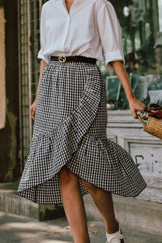 Mango midi gingham skirt, midi skirt, check printed skirt, how to wear a midi skirt from zara, the popular zara gingham skirt, where to find the gingham skirt from instagram, asos oversized white shirt, topshop oversize white button down shirt, boyfriend shirt, basic white shirt, a white shirt can work with everything in your wardrobe, closet staples, wardrobe staples, love my basic pieces, gucci ace heart embroidered sneakers, boho peach etsy mini straw bag, french knotted skirt scarf, the cutest straw bag for summer, where to find the best woven bag, raffia bag, wicker bag, mini straw bag, small straw bag, round handles bag, bags to fall in love with, how to make a statement with a mini straw bag, the straw bag that elevates all your summer outfits, tinted sunglasses, black nirvana oval sunglasses, vintage sunglasses, sunnies, tinted sunnies, the tinted sunglasses that are trending, h&m straw boater hat, andreea birsan, 100 ways to wear a white shirt, couturezilla, gucci leather belt, GG buckle belt, the popular Gucci belt, statement earrings, thunder bolt, shinny, statement sneakers, white kicks, white leather sneakers, sneakers with hearts, gucci sneakers, high luxury and high street items, cute summer outfit ideas 2017, how to look Parisian chic, European summer street style inspiration for women 2017, pinterest chic outfit ideas for woman, summer outfit ideas, summer ootd inspiration, outfit of the day, ootd, fashion icon, style inspiration, fashionista, fashion inspiration, style inspo, what to wear in summer, how to look French, chic on a budget, zara outfit, mango, topshop, asos, river island, forever 21, urban outfitters, how to mix high end pieces with luxury ones, zara and Gucci, how to look chic when not wearing a dress, outfit alternatives for summer, tomboy chic, minimal outfit, tumblr girls photos, pictures, happy girl, women, smart casual outfits, the best outfit ideas 2017, what to wear when you don't feel inspired, summer in Europe, weekend attire, uniform, French women in summer, European outfit ideas 2017, minimal chic outfit, how to stand out, the best outfit ideas for summer, the sunglasses you have seen everywhere on Instagram, glasses, uk fashion blogger, united kingdom, uk fashion blog, fashion and travel blog, Europe, women with style, street style, summer fashion trends 2017