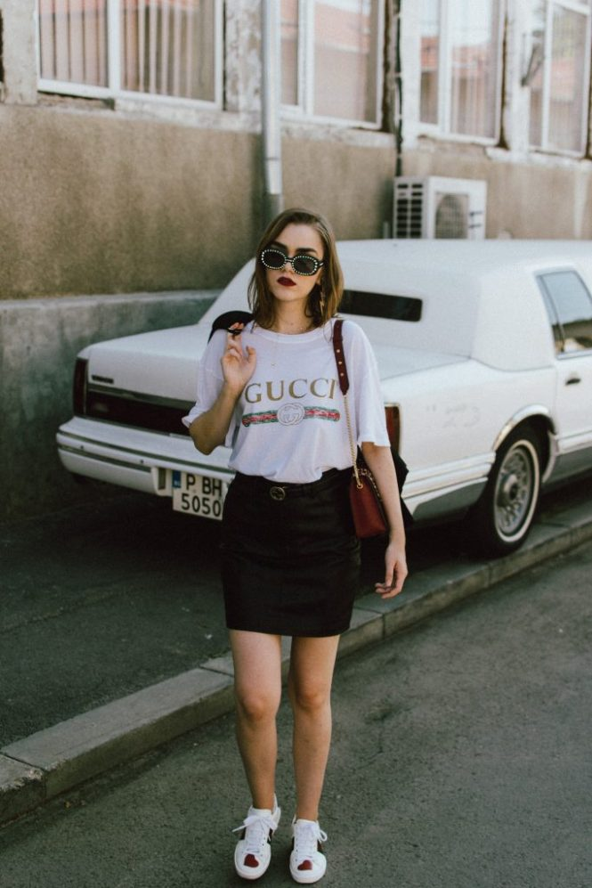 Gucci t-shirt, mango mini skirt, zara blazer, furla ruby red leather lace metropolis shoulder bag, gucci ace heart embroidered sneakers, asos sunglasses, andreea birsan, couturezilla, transitional cute summer outfit ideas 2017, transitional dressing, transitional outfit, gucci logo tee for women, zara a line black leather mini skirt, statement sneakers with hearts, white leather sneakers, choker necklace with stars, gold accessories, square 90s sunglasses, vintage looking sunglasses, double breasted golden buttons black tailored blazer, transitional blazer, the popular gucci t-shirt from instagram, the best blazer for autumn, fall dressing, fall outfit, back to school ootd, too cool for school, statement earrings with thunderbolt, h&m earrings, red lipstick, ombre medium length hair, how to wear a mini skirt and not look like a teenager, mini skirt, black leather mini skirt, tube skirt, mvn blazer, the cute gucci sneakers, how to look Parisian chic, European summer street style inspiration for women 2017, pinterest chic outfit ideas for woman, summer outfit ideas, summer ootd inspiration, outfit of the day, ootd, fashion icon, style inspiration, fashionista, fashion inspiration, style inspo, what to wear in summer, how to look French, chic on a budget, zara outfit, mango, topshop, asos, river island, forever 21, urban outfitters, how to mix high end pieces with luxury ones, zara and Gucci, how to look chic when not wearing a dress, outfit alternatives for summer, tomboy chic, minimal outfit, tumblr girls photos, pictures, happy girl, women, smart casual outfits, the best outfit ideas 2017, what to wear when you don't feel inspired, summer in Europe, weekend attire, uniform, French women in summer, European outfit ideas 2017, minimal chic outfit, how to stand out, the best outfit ideas for summer, the sunglasses you have seen everywhere on Instagram, glasses, uk fashion blogger, united kingdom, uk fashion blog, fashion and travel blog, Europe, women with style, street style, summer fashion trends 2017, best fashion ideas, styling