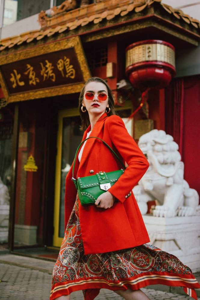 Zara double breasted long orange blazer, h&m patterned orange asymmetric midi skirt, gucci white and red leather sneakers, prada green saffiano leather shoulder bag, prada bag with studs and stones, mango organic cotton white t-shirt, basic white tee, orange tinted retro sunglasses, andreea birsan, couturezilla, cute spring outfit ideas 2018, work appropriate outfit ideas, office outfit ideas, business casual outfit ideas, fresh spring outfits, how to colorblock like a pro, green and orange outfit, china town editorial, gold jewellry, pandora shine, name necklace, sac necklace, how to layer necklaces, gold hoop earrings, statement jewellry, how to wear sneakers with a business appropriate outfit, smart casual ootd, casual and business outfit, how to wear orange in 2018, how to look Parisian chic, European summer street style inspiration for women 2017, pinterest chic outfit ideas for woman, summer outfit ideas, summer ootd inspiration, outfit of the day, ootd, fashion icon, style inspiration, fashionista, fashion inspiration, style inspo, what to wear in summer, how to look French, chic on a budget, zara outfit, mango, topshop, asos, river island, forever 21, urban outfitters, how to mix high end pieces with luxury ones, zara and Gucci,outfit alternatives for summer, tomboy chic, minimal outfit, tumblr girls photos, pictures, happy girl, women, smart casual outfits, the best outfit ideas 2017, what to wear when you don't feel inspired, summer in Europe, weekend attire, uniform, French women in summer, European outfit ideas 2017, minimal chic outfit, how to stand out, the best outfit ideas for summer, the sunglasses you have seen everywhere on Instagram, glasses, uk fashion blogger, united kingdom, uk fashion blog, fashion and travel blog, Europe, women with style, street style, summer fashion trends 2017, best fashion ideas, styling, fall fashion, fall outfit, fall ootd, fall perfect, transitional dressing, best transitional outfit ideas, how to wear statement earrings, dressing for autumn, autumn outfit, winter outfit ideas for work and school 2017