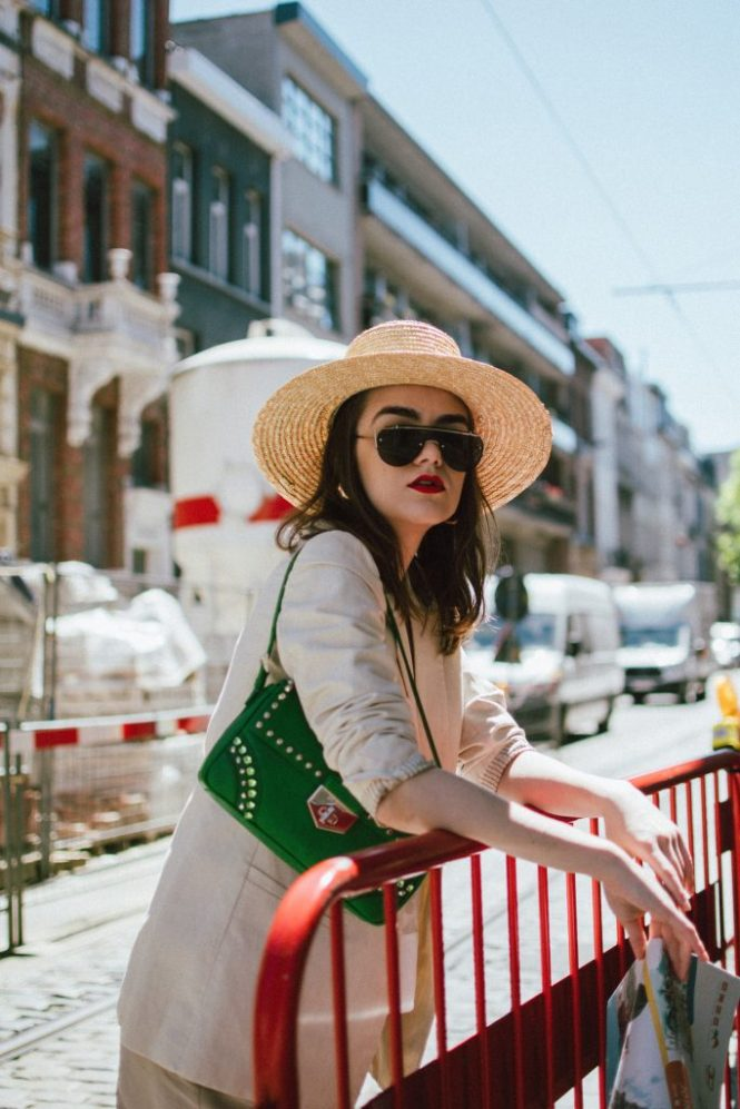 Mango khaki linen shorts, zara beige linen blazer, massimo dutti white cami top with floral insertions, gucci ace heart embroidered sneakers, green prada shoulder bag with studs and stones bag, asos straw boater hat, boohoo big sunglasses, andreea birsan, couturezilla, cute spring and summer outfit ideas 2018, cotton and linen outfit, what materials to wear in spring and summer, heat friendly fabrics, gucci white leather sneakers, sneakers with hearts, gucci sneakers, gucci kicks, gucci white trainers, oversize sunglasses, oversized, huge sunglasses trend, straw hat, summer hat, green shoulder bag, khaki beige white and green outfit, color combinations for spring and summer, antwerp fashion, outfits of antwerp, how to dress for hot spring days in antwerp, travel to belgium, tourist outfit for summer, chic tourist, shorts, linen shorts, cotton shorts, khaki shorts, how to look Parisian chic, European summer street style inspiration for women 2017, pinterest chic outfit ideas for woman, summer outfit ideas, summer ootd inspiration, outfit of the day, ootd, fashion icon, style inspiration, fashionista, fashion inspiration, style inspo, what to wear in summer, how to look French, chic on a budget, zara outfit, mango, topshop, asos, river island, forever 21, urban outfitters, how to mix high end pieces with luxury ones, zara and Gucci,outfit alternatives for summer, tomboy chic, minimal outfit, tumblr girls photos, pictures, happy girl, women, smart casual outfits, the best outfit ideas 2017, what to wear when you don't feel inspired, summer in Europe, weekend attire, uniform, French women in summer, European outfit ideas 2017, minimal chic outfit, how to stand out, the best outfit ideas for summer, the sunglasses you have seen everywhere on Instagram, glasses, uk fashion blogger, united kingdom, uk fashion blog, fashion and travel blog, Europe, women with style, street style, summer fashion trends 2017, best fashion ideas, styling, fall fashion, fall outfit, fall ootd, fall perfect, transitional dressing, best transitional outfit ideas, how to wear statement earrings, dressing for autumn, autumn outfit, winter outfit ideas for work and school 2017