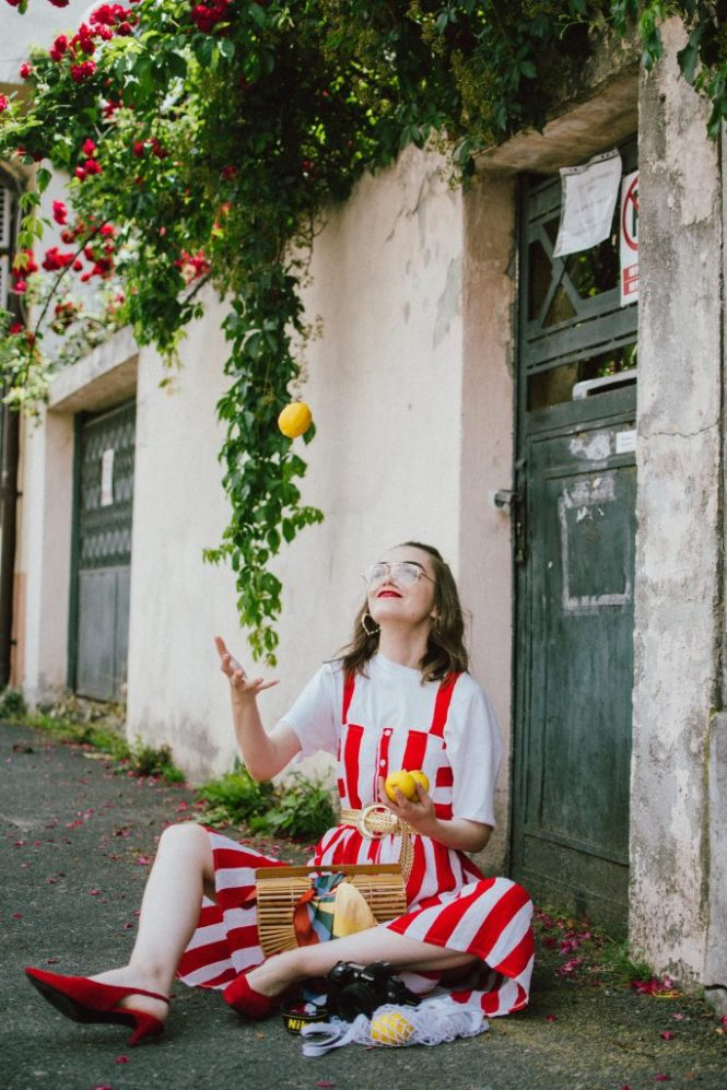 Midi striped dress, white t-shirt, red slingback shoes, cult gaia bag, andreea birsan, couturezilla, cute summer outfit ideas 2018, boohoo red and white striped midi dress, stripe, stripes dress, the perfect summer bag, cult gaia bag, cult gaia lookalike bag, the popular cult gaia bag you have seen all over instagram, zara clear lens aviator glasses, h&m suede kitten heel sling back shoes, red slingback shoes, slingbacks, cotton white t-shirt, white tee, basic white tee, how to layer a dress, dress over tshirt, summer layers, how to layer in summer, roses, heart shaped earrings, bamboo bag, basket bag, raffia bag, handmade bag, woven bag, wicker bag, the perfect summer dress, what to wear when it's hot, how to look Parisian chic, European summer street style inspiration for women 2017, pinterest chic outfit ideas for woman, summer outfit ideas, summer ootd inspiration, outfit of the day, ootd, fashion icon, style inspiration, fashionista, fashion inspiration, style inspo, what to wear in summer, how to look French, chic on a budget, zara outfit, mango, topshop, asos, river island, forever 21, urban outfitters, how to mix high end pieces with luxury ones, zara and Gucci,outfit alternatives for summer, tomboy chic, minimal outfit, tumblr girls photos, pictures, happy girl, women, smart casual outfits, the best outfit ideas 2017, what to wear when you don't feel inspired, summer in Europe, weekend attire, uniform, French women in summer, European outfit ideas 2017, minimal chic outfit, how to stand out, the best outfit ideas for summer, the sunglasses you have seen everywhere on Instagram, glasses, uk fashion blogger, united kingdom, uk fashion blog, fashion and travel blog, Europe, women with style, street style, summer fashion trends 2017, best fashion ideas, styling, fall fashion, fall outfit, fall ootd, fall perfect, transitional dressing, best transitional outfit ideas, how to wear statement earrings, dressing for autumn, autumn outfit, winter outfit ideas for wor